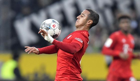 File -- In this Saturday, Dec. 7, 2019 file photo Bayern's Thiago plays during the German Bundesliga soccer match between Borussia Moenchengladbach and Bayern Munich at the Borussia Park in Moenchengladbach, Germany. Thiago Alcantara is joining Liverpool after ending his seven-year stint at European champion Bayern Munich. (AP Photo/Martin Meissner, file)