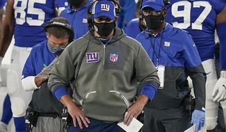 FILE - In this Monday, Sept. 14, 2020, file photo, New York Giants head coach Joe Judge, center, watches play from the sidelines during the fourth quarter of an NFL football game against the Pittsburgh Steelers in East Rutherford, N.J. The Bears hope to win back-to-back games to start a season for the first time in seven years and deny the Giants their first victory under new coach Joe Judge when New York visits Soldier Field on Sunday. (AP Photo/Seth Wenig, File)