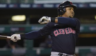 Cleveland Indians' Jose Ramirez (11) hits a two-run home run against the Detroit Tigers in the fourth inning of a baseball game in Detroit, Thursday, Sept. 17, 2020. (AP Photo/Paul Sancya)