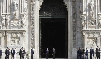 German President Frank-Walter Steinmeier, is flanked by Italian President Sergio Mattarella after visiting the Duomo gothic cathedral, in Milan, Italy, Thursday, Sept. 17, 2020. Steinmeier is scheduled to meet doctors, medical staff and former patients to discuss the coronavirus pandemic and Germany's support to Italy during his two-day visit. (AP Photo/Luca Bruno)
