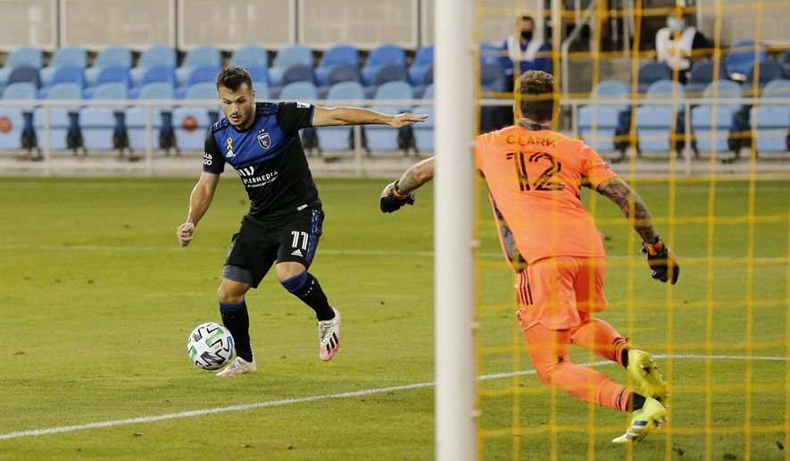 San Jose Earthquakes midfielder Valeri Kazaishvili (11) sets up to shoot against Portland Timbers goalkeeper Steve Clark (12), scoring a goal during the second half of an MLS soccer match Wednesday, Sept. 16, 2020, in San Jose, Calif.