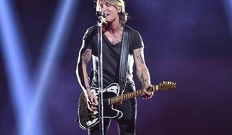 "FILE - This Nov. 14, 2018 file photo shows Keith Urban performing at the 52nd annual CMA Awards in Nashville, Tenn. Urban's latest album ""The Speed of Now Part 1"" comes out Friday. (Photo by Charles Sykes/Invision/AP, File)"