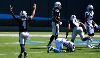 Las Vegas Raiders quarterback Derek Carr celebrates after a touchdown by Josh Jacobs during the first half of an NFL football game against the Carolina Panthers Sunday, Sept. 13, 2020, in Charlotte, N.C. (AP Photo/Mike McCarn)