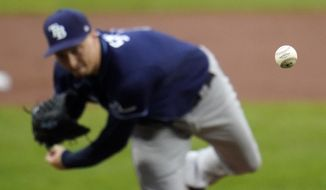 Tampa Bay Rays starting pitcher Blake Snell throws a pitch to the Baltimore Orioles during the first inning of a baseball game, Thursday, Sept. 17, 2020, in Baltimore. (AP Photo/Julio Cortez)