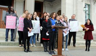In this Feb. 12, 2020 file photo, Danbury High School sophomore Alanna Smith speaks during a news conference at the Connecticut State Capitol in Hartford, Conn. The U.S. Department of Education is threatening to withhold some federal funding for Connecticut school districts if they follow a state policy that allows transgender girls to compete as girls in high school sports. In response to a complaint filed last year by several cisgender female track athletes, including Smith, who argued that two transgender female runners had an unfair physical advantage, the federal agency's office for civil rights determined in May that Connecticut's policy violates the civil rights of athletes who are not transgender. (AP Photo/Pat Eaton-Robb, File)  **FILE**
