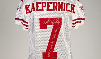 It is bright red and white, and autographed by Colin Kaepernick in 2011 with silver ink. It also could fetch $100,000 in the near future says Julien's Auctions, a California-based auctioneer which will put the garment on the bidding block in December. (IMAGE COURTESY OF JULIEN'S AUCTIONS)