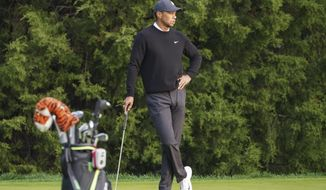 Tiger Woods pauses on the fourth tee during practice before the U.S. Open Championship golf tournament at Winged Foot Golf Club, Wednesday, Sept. 16, 2020, in Mamaroneck, N.Y. (AP Photo/John Minchillo)