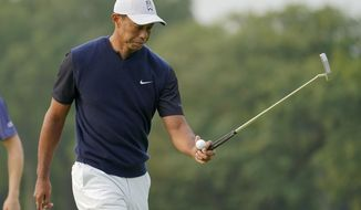 Tiger Woods prepares to putt on the first green during the first round of the US Open Golf Championship, Thursday, Sept. 17, 2020, in Mamaroneck, N.Y. (AP Photo/John Minchillo)