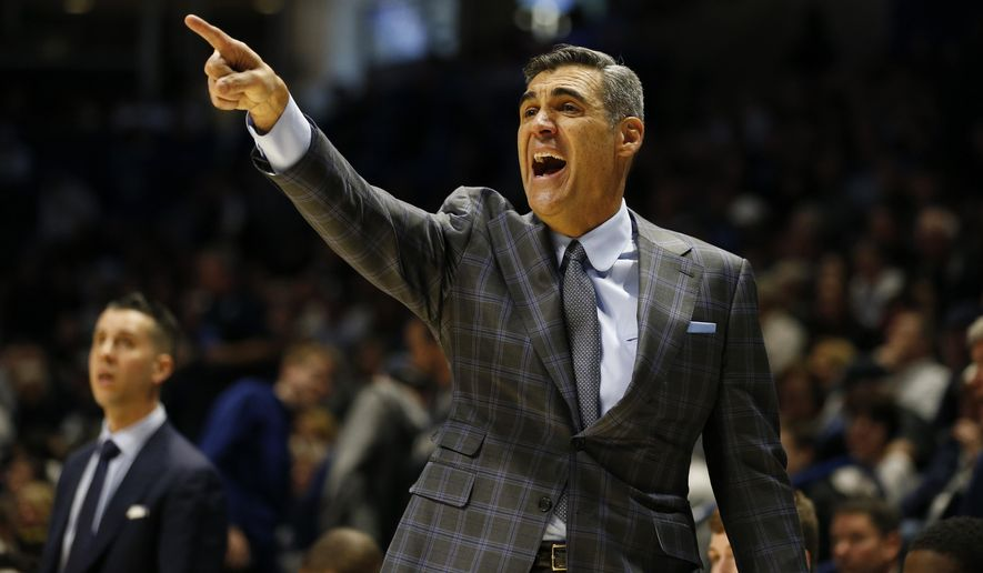 FILE - In this Feb. 22, 2020, file photo, Villanova head coach Jay Wright directs his team during the second half of an NCAA college basketball game against Xavier in Cincinnati. The Division I Council voted Wednesday, Sept. 16, 2020, to start the NCAA men's and women's basketball season Nov. 25, the day before Thanksgiving. (AP Photo/Gary Landers, File)