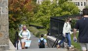 College students wear masks our of concern for the coronavirus on the Boston College campus, Thursday, Sept. 17, 2020, in Boston. (AP Photo/Steven Senne)