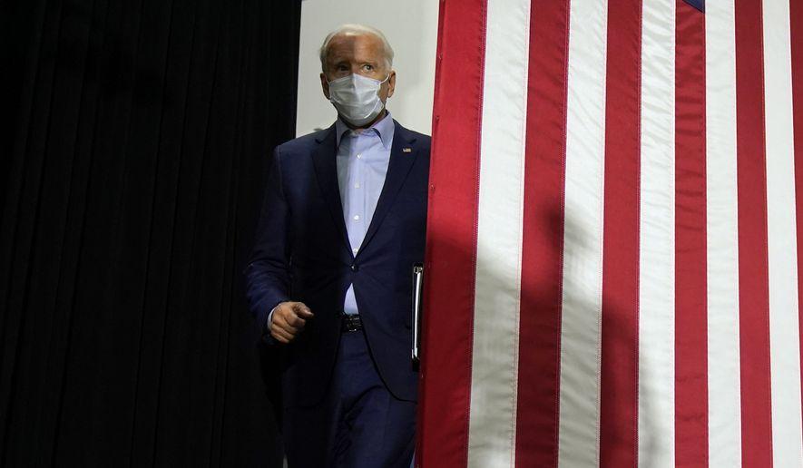 Democratic presidential candidate former Vice President Joe Biden walks in to speak at a union training center in Hermantown, Minn., Friday, Sept. 18, 2020. (AP Photo/Carolyn Kaster)