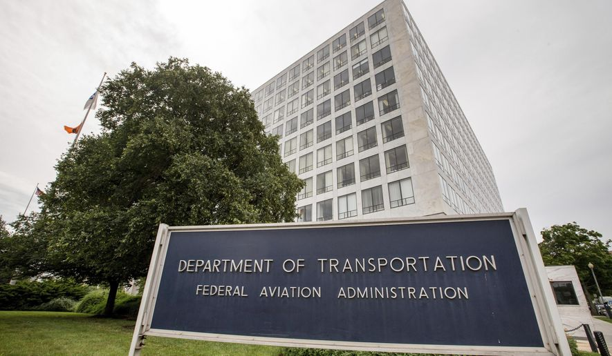 FILE - This June 19, 2015, file photo, shows the Department of Transportation Federal Aviation Administration building in Washington.  The Transportation Department's Inspector General said in an audit report published Friday, Sept. 18, 2020, that the FAA and hasn't done enough research to evaluate the new risks. In addition, it says the FAA largely only updates standards after accidents and hasn't revised them since a 1991 accident. (AP Photo/Andrew Harnik, File)