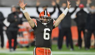 Cleveland Browns quarterback Baker Mayfield celebrates after running back Kareem Hunt scored a touchdown during the second half of the team's NFL football game against the Cincinnati Bengals, Thursday, Sept. 17, 2020, in Cleveland. The Browns won 35-30. (AP Photo/David Richard)