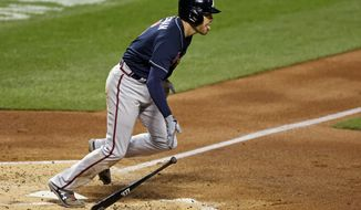 Atlanta Braves' Freddie Freeman starts to run after hitting a two-RBI double during the second inning of a baseball game against the New York Mets, Friday, Sept. 18, 2020, in New York. (AP Photo/Adam Hunger)