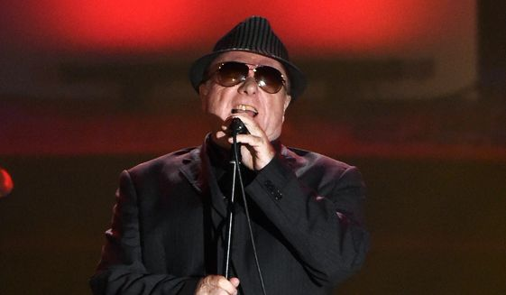 In this June 18, 2015, file photo, Van Morrison performs at the 46th annual Songwriters Hall of Fame Induction and Awards Gala in New York. Van Morrison is to release three new songs over the coming weeks that take a swipe at the lockdown restrictions imposed by the British government. (Photo by Evan Agostini/Invision/AP, File)