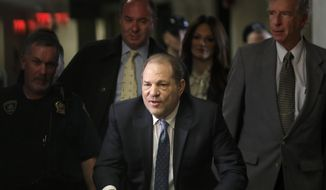 In this Monday, Feb. 24, 2020 file photo, Harvey Weinstein arrives at a Manhattan courthouse for jury deliberations in his rape trial, in New York. Britain has stripped disgraced movie mogul Harvey Weinstein of an honor recognizing his contribution to the UK film industry. The 68-year-old Weinstein was given the honor in 2004 and the decision to take it away was announced Friday Sept. 18, 2020. (AP Photo/Seth Wenig, File)  **FILE**