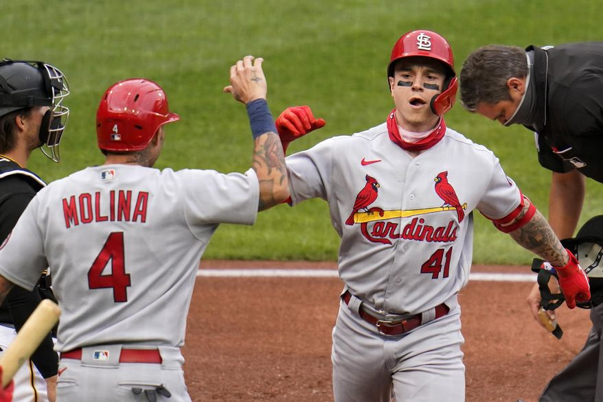 St. Louis Cardinals' Tyler O'Neill (41) celebrates with Yadier Molina (4) as he heads to the dugout after hitting a two-run home run off Pittsburgh Pirates starting pitcher Trevor Williams during the second inning of the first baseball game of a doubleheader in Pittsburgh, Friday, Sept. 18, 2020. (AP Photo/Gene J. Puskar)