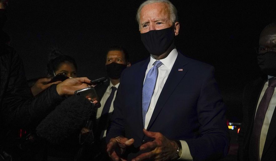 Democratic presidential candidate former Vice President Joe Biden talks with reporters at Wilkes-Barre Scranton International Airport, in Avoca, Pa., after a CNN town hall Thursday, Sept. 17, 2020. (AP Photo/Carolyn Kaster)