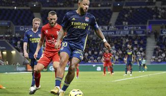 Lyon's Memphis Depay controls the ball during the French League One soccer match between Lyon and Nimes in Decines, near Lyon, central France, Friday, Sept. 18, 2020. (AP Photo/Laurent Cipriani)