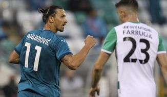 AC Milan's Zlatan Ibrahimovic, left, celebrates after he scored his side's first goal during an Europa League second qualifying round soccer match between Shamrock Rovers and AC Milan at the Tallaght Stadium in Dublin, Thursday, Sept. 17, 2020. (AP Photo/Peter Morgan)