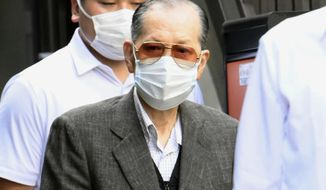 Takayoshi Yamaguchi, the 78-year-old former chairman of now defunct Japan Life, is arrested and led by police  in Tokyo, Friday, Sept. 18, 2020. Japanese police arrested Yamaguchi, who was invited to one of annual cherry blossom viewing parties hosted by the former Prime Minister Shinzo Abe, in a massive fraud involving thousands of elderly customers.(Kyodo News via AP)