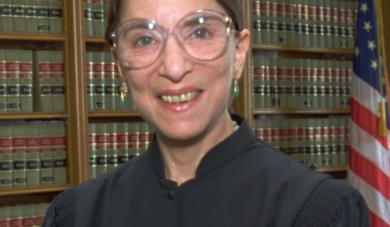 FILE - In this April 3, 1993, file photo, Judge Ruth Bader Ginsburg poses in her office at U.S. District Court in Washington. The Supreme Court says Supreme court Justice Ruth Bader Ginsburg has died of metastatic pancreatic cancer at age 87. (AP Photo/Doug Mills, File)