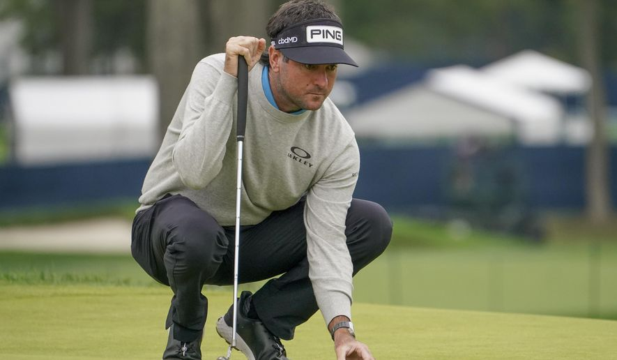 Bubba Watson, of the United States, lines up his putt on the fifth green during the second round of the US Open Golf Championship, Friday, Sept. 18, 2020, in Mamaroneck, N.Y. (AP Photo/John Minchillo)