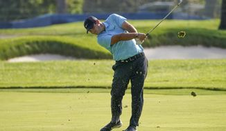 Patrick Reed, of the United States, plays a shot off the second fairway during the second round of the US Open Golf Championship, Friday, Sept. 18, 2020, in Mamaroneck, N.Y. (AP Photo/John Minchillo)