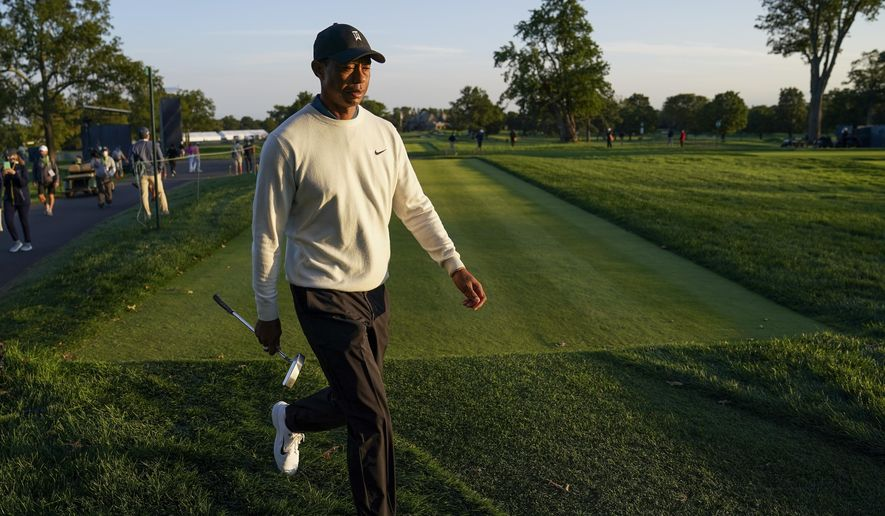 Tiger Woods, of the United States, walks up to the ninth tee during the second round of the US Open Golf Championship, Friday, Sept. 18, 2020, in Mamaroneck, N.Y. (AP Photo/John Minchillo)