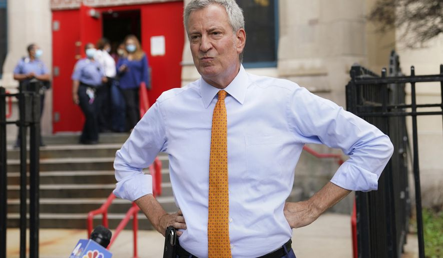 In this Aug. 19, 2020, file photo, New York Mayor Bill de Blasio speaks to reporters after visiting New Bridges Elementary School in the Brooklyn borough of New York, to observe pandemic-related safety procedures. (AP Photo/John Minchillo, File) ** FILE **