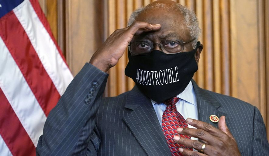 House Majority Whip James Clyburn, of S.C., shields his eyes from a television light to look at a reporter asking a question during a news conference with House Speaker Nancy Pelosi of Calif., about COVID-19, Thursday, Sept. 17, 2020, on Capitol Hill in Washington. (AP Photo/Jacquelyn Martin)