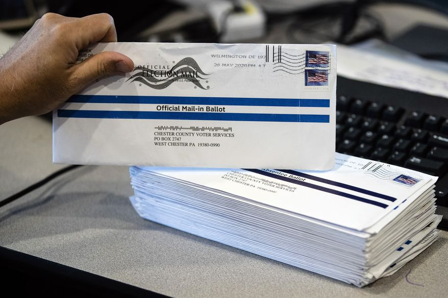 In this May 28, 2020, file photo, mail-in primary election ballots are processed at the Chester County Voter Services office in West Chester, Pa.  On Thursday, Sept. 24, the U.S. Justice Department said it discovered ballots cast for President Trump in Luzerne County, Pa., were discarded. (AP Photo/Matt Rourke, File)  **FILE**
