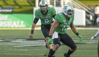 Marshall quarterback Grant Wells (8) rushes upfield on a keeper against Appalachian State during an NCAA college football game Saturday, Sept. 19, 2020, in Huntington, W.Va. (Sholten Singer/The Herald-Dispatch via AP)