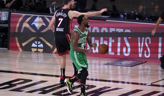 Boston Celtics guard Kemba Walker (8) celebrates forcing a turnover against Miami Heat's Goran Dragic (7) during the second half of an NBA conference final playoff basketball game, Saturday, Sept. 19, 2020, in Lake Buena Vista, Fla. (AP Photo/Mark J. Terrill)