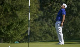 Patrick Reed, of the United States, reacts after missing a putt on the eighth green during the third round of the US Open Golf Championship, Saturday, Sept. 19, 2020, in Mamaroneck, N.Y. (AP Photo/John Minchillo)