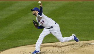 New York Mets starting pitcher David Peterson throws to an Atlanta Braves batter during the third inning of a baseball game Saturday, Sept. 19, 2020, in New York. (AP Photo/Noah K. Murray)