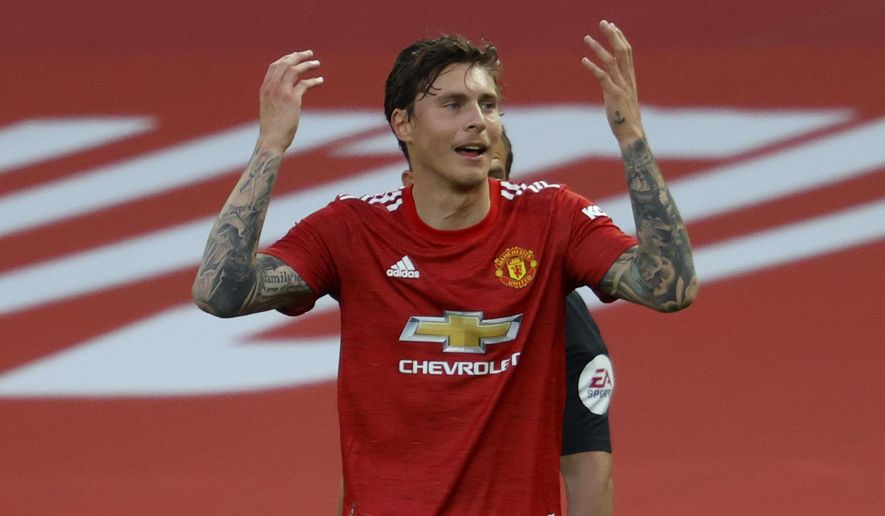 Manchester United's Victor Lindelof reacts after a penalty is awarded to Crystal Palace upon VAR review during the English Premier League soccer match between Manchester United and Crystal Palace at the Old Trafford stadium in Manchester, England, Saturday, Sept. 19, 2020. (Richard Heathcote/Pool via AP)