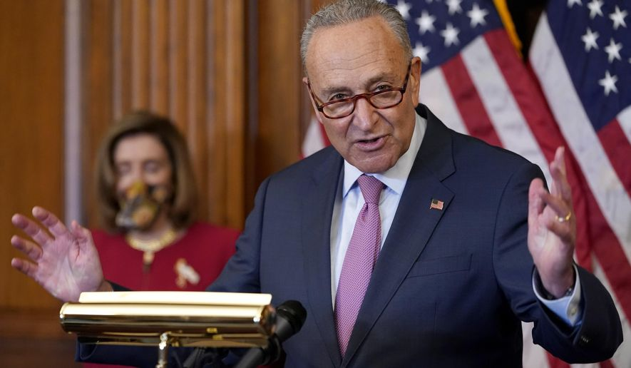 In this file photo, Senate Minority Leader Sen. Chuck Schumer of N.Y., right, speaks next to House Speaker Nancy Pelosi of Calif., during a news conference about COVID-19, Thursday, Sept. 17, 2020, on Capitol Hill in Washington. (AP Photo/Jacquelyn Martin)  **FILE**
