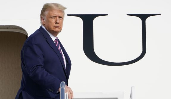 President Donald Trump pauses at the top of the steps of Air Force One at Andrews Air Force Base, Md., Friday, Sept. 18, 2020. Trump is heading to Minnesota for a campaign rally. (AP Photo/Susan Walsh)