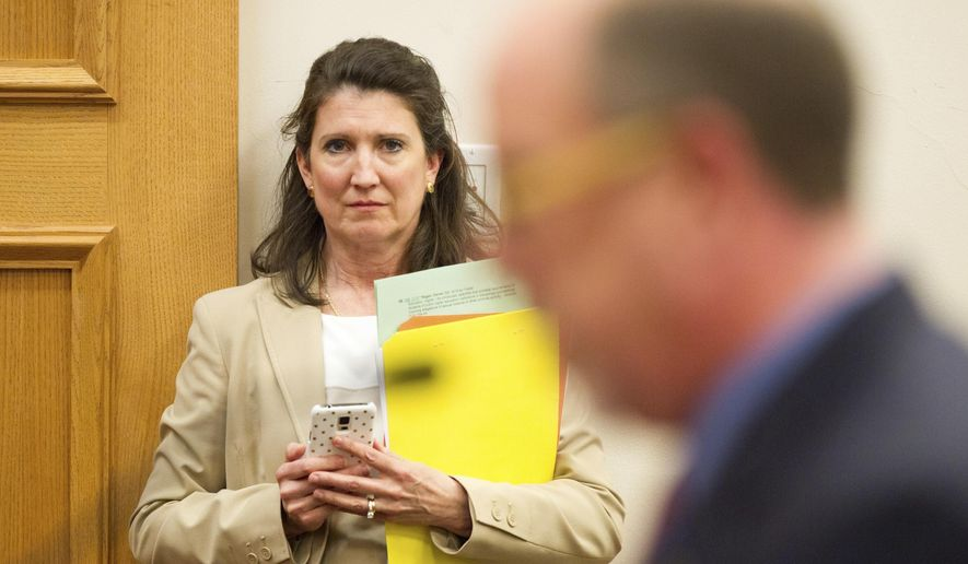 FILE - In this March 15, 2016 file photo, Rep. Susan Lynn, R-Mt. Juliet, listens to the testimony during a House subcommittee hearing in Nashville, Tenn.  Walmart, Amazon and other corporate giants donated money to Lynn's re-election campaign after she used social media to amplify and promote the QAnon conspiracy theory. That's according to an Associated Press review of campaign finance records and online posts by Republican state Rep. Susan Lynn.(AP Photo/Erik Schelzig, File)