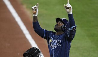 Tampa Bay Rays' Randy Arozarena celebrates his two-run home run during the fifth inning of a baseball game against the Baltimore Orioles, Saturday, Sept. 19, 2020, in Baltimore. (AP Photo/Nick Wass)