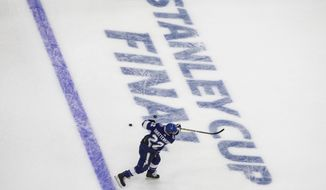 Tampa Bay Lightning defenseman Kevin Shattenkirk (22) skates during warmups before taking on the Dallas Stars during NHL Stanley Cup finals hockey action in Edmonton, Alberta, Saturday, Sept. 19, 2020. (Jason Franson/The Canadian Press via AP)