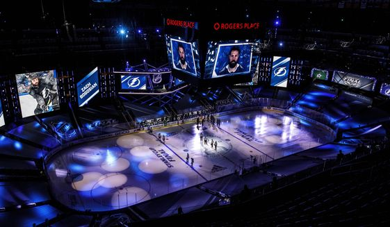 The Dallas Stars and the Tampa Bay Lightning line up for the national anthem during NHL Stanley Cup finals hockey action in Edmonton, Alberta, Saturday, Sept. 19, 2020. (Jason Franson/The Canadian Press via AP)