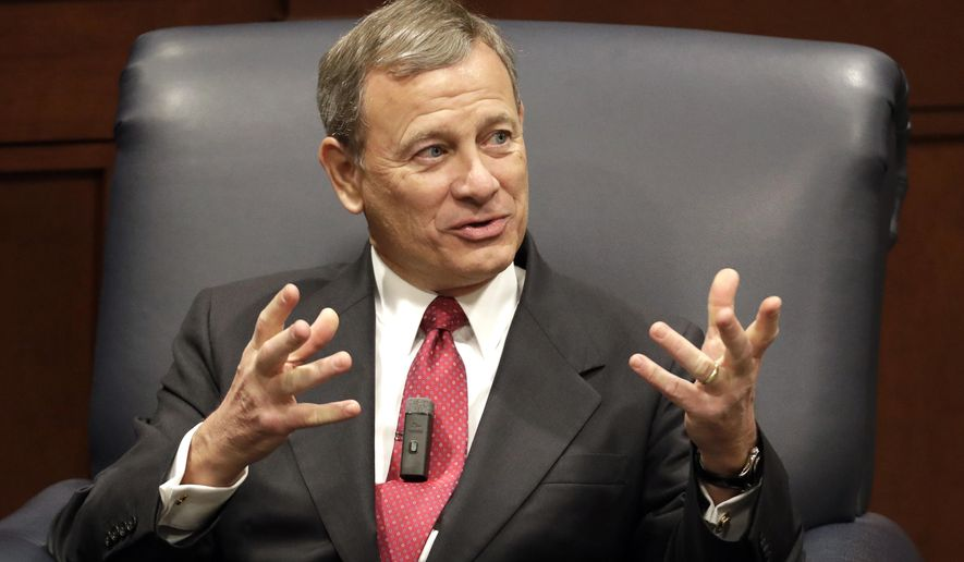 FILE - In this Feb. 6, 2019 file photo, Supreme Court Chief Justice John Roberts answers questions during an appearance at Belmont University in Nashville, Tenn. U.S. Chief Justice John Roberts, a pick of former President George W. Bush, has endured GOP anger over decisions ranging from immigration to pandemic restrictions on church gatherings. Roberts has pushed back, warning that political polarization is skewing how people view the judicial branch. (AP Photo/Mark Humphrey, File)