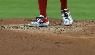 Cincinnati Reds' Trevor Bauer stands on the pitcher's mound in the first inning during a baseball game against the Chicago White Sox in Cincinnati, Saturday, Sept. 19, 2020. (AP Photo/Aaron Doster) **FILE**
