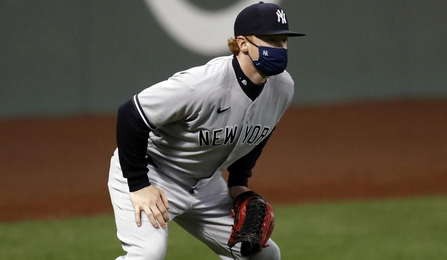 New York Yankees' Clint Frazier wears a mask while playing in left field against the Boston Red Sox during the fourth inning of a baseball game Friday, Sept. 18, 2020, in Boston. (AP Photo/Michael Dwyer)