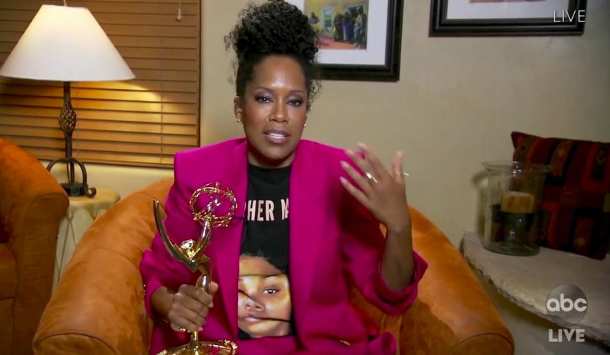 """In this video grab captured on Sept. 20, 2020, courtesy of the Academy of Television Arts & Sciences and ABC Entertainment, Regina King accepts the award for outstanding lead actress in a limited series or movie for """"Watchmen"""" during the 72nd Emmy Awards broadcast. (The Television Academy and ABC Entertainment via AP)"""