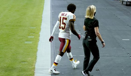 Washington Football Team wide receiver Steven Sims (15) leaves the field during the second half of an NFL football game against the Arizona Cardinals, Sunday, Sept. 20, 2020, in Glendale, Ariz. (AP Photo/Ross D. Franklin)  **FILE**