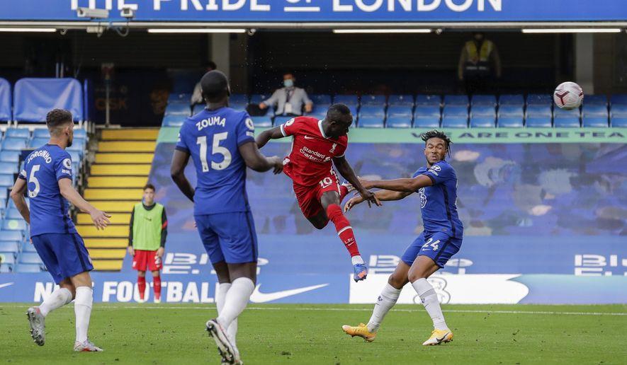 Liverpool's Sadio Mane scores during the English Premier League soccer match between Chelsea and Liverpool at Stamford Bridge Stadium, Sunday, Sept. 20, 2020. (AP Photo/Matt Dunham, Pool)