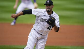 Colorado Rockies starting pitcher Antonio Senzatela works against the Los Angeles Dodgers in the first inning of a baseball game Sunday, Sept. 20, 2020, in Denver. (AP Photo/David Zalubowski)